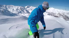 SELFIE: Extreme freeride snowboarder riding powder snow off-piste in mountains Stock Footage