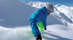 SELFIE: Extreme freeride snowboarder riding powder off-piste and falls into snow Stock Footage