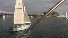 Sailboat 180 turn to run line waiting for race as seen from bimini top in the Stock Footage