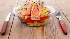 Pink salmon on italian traditional tagliatelles backed with tom Stock Footage