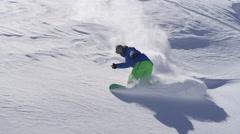 SLOW MOTION: Extreme snowboarder doing powder turn in fresh mountain snow Stock Footage