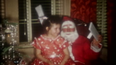 Santa visits a family in suburbia on Christmas Eve, 3596-vintage film home movie Stock Footage