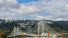 Time lapse of clouds and auto traffic with Tilikum Crossing in Portland Oregon Stock Footage