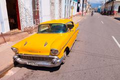 CIENFUEGOS, CUBA - SEPTEMBER 12, 2015: Classic cars are still in use and old Kuvituskuvat