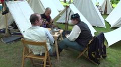 Civil War soldier sitting around the encampment Stock Footage