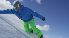 SLOW MOTION: Snowboarder riding powder snow and doing hand drag past the camera Stock Footage