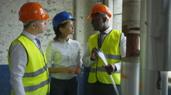 4K Architects or engineers looking at fiber optic cable & having a discussion Stock Footage