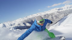SLOW MOTION: Cheerful snowboarder riding powder snow in mountain backcountry Stock Footage