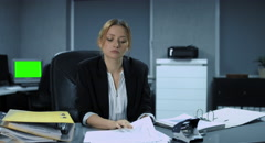 4K: A young, easily overtired clerks files away the last documents Stock Footage