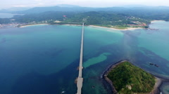 Aerial shot of long Tsunoshima bridge over blue ocean Stock Footage
