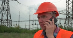 Engineer talking on the phone Stock Footage