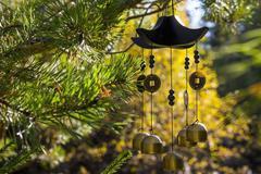 Wind chimes in autumn garden Stock Photos