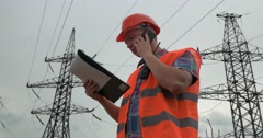 Worker with a walkie-talkie at a power plant Stock Footage