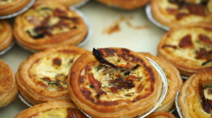 Pile of mini Quiche French style pie with cheese spinach and bacon Stock Footage