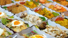 Row of Thai ready made meal in paper box to buy at local market Stock Footage