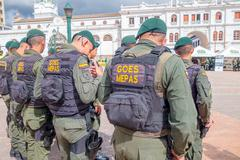 PASTO, COLOMBIA - JULY 3, 2016: police wearing uniform and lifejackets standing Stock Photos