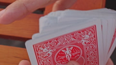 Closeup Conjurer Hands Shuffle Cards for Trick above Table Stock Footage