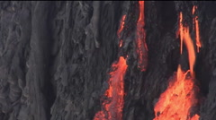 Molten lava flows from a volcano. Stock Footage
