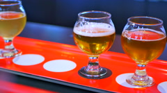4K Hand Poured Beer Glass Samples, Craft Brewery Pub Tasting, Beers and Ales Stock Footage