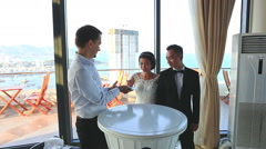 Conjurer Shows Card Trick for Bride Groom in Hotel Lobby Stock Footage