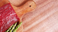 Red raw beef fillet on wood Stock Footage