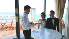 Conjurer Juggles with Card Pack for Bride Groom in Hotel Lobby Stock Footage