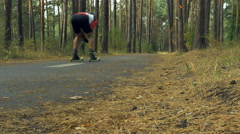 Riders on ski-rollers in forest Stock Footage