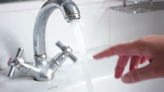 Water from opened faucet Stock Footage
