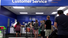 People line up for returning goods at customer service counter Stock Footage