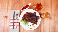 Rural design new york meat style beef steak fillet on white plat Stock Footage