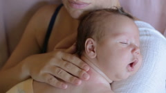 Lovely baby is falls asleep at the mother's hands Stock Footage