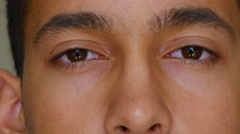 Extreme Close Up of Young Male Opening Eyes Stock Footage