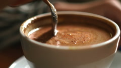 Teaspoon stir crema. Unknown going to drink latte in the white mug Stock Footage