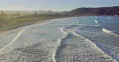 Aerial Of Whangamata Beach ocean surf, Coromandel, New Zealand Stock Footage