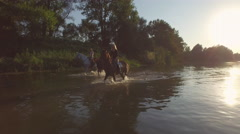 CLOSE UP: Three girlfriends riding horses in the river on wonderful sunny day Stock Footage