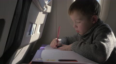 Child drawing during the flight Stock Footage