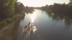 CLOSE UP: Three girlfriends riding horses in the river at beautiful sunny day Stock Footage