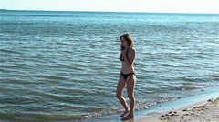 Girl goes to sea. Slowmotion Stock Footage