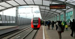 The modern railway station, the passengers go to the train Stock Footage