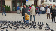 4K Young Girl Hand Feeding Birds, City Urban Square, Fun with Flying Pigeons Stock Footage