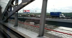 The drive train on the bridge, the view from the train window on the city Stock Footage
