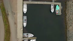 Aerial shot of the fishing boats in a harbor at Cape Breton Stock Footage