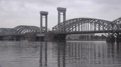 Lastochka special express train crosses Neva River along a bridge Stock Footage