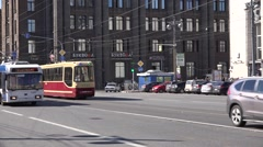 Two blue trolleybuses and refurbished vintage styled tram Stock Footage