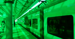 Unusual green glass station, the train departs from the platform Stock Footage