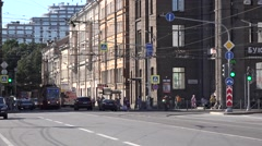 Two-sided tram on temporary route 6A turns left nedar the Finland Railway Stn Stock Footage
