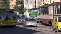 Tram, tolleybus, buses and motorcars cross a railway level crossing Stock Footage