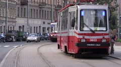 2 two-sided oncoming trams meet at sideway segregation Stock Footage
