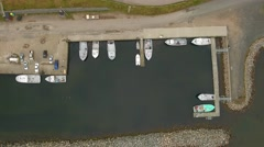 Aerial shot of the fishing boats in harbor at Cape Breton Stock Footage