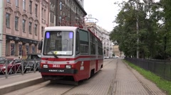 Two-sided tram departs from a stub terminus Stock Footage